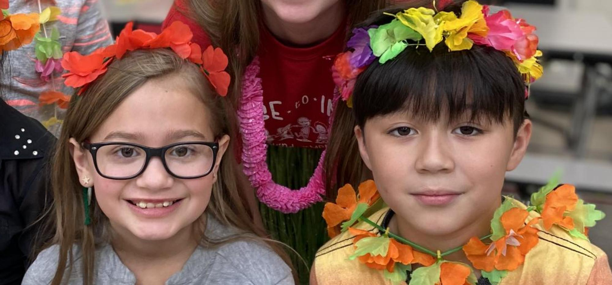 Students with Flower Leis on their heads